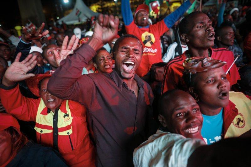 Supporters of President Uhuru Kenyatta cheer as they celebrate his victory in the presidential election, in Nairobi, Kenya, on August 8. Photo by Das Kurokawa/EPA