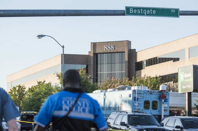 Prosecutors filed an indictment Friday against a shooting suspect in the shooting at the Capital Gazette building (seen behind) in Annapolis, Md., on June 28. File Photo by Jay Fleming/EPA-EFE