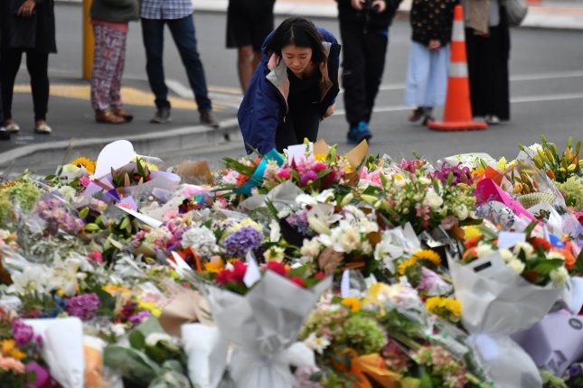 A makeshift memorial near Al Noor Masjid in Christchurch, New Zealand, honors the victims of a mass shooting there in March. File Photo by Mick Tskias/EPA-EFE