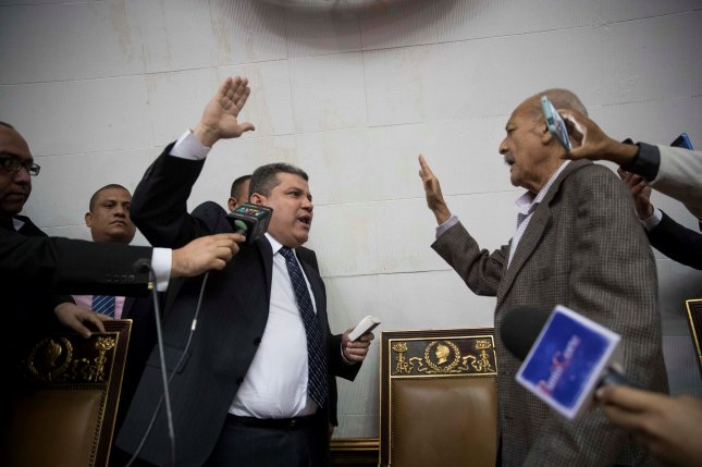 The United States on Monday sanctioned Venezuelan lawmaker Luis Parra (L) and six other current and former officials for their role in attempting to seize control over the National Assembly. Photo courtesy of Rayner Pena R./EPA-EFE