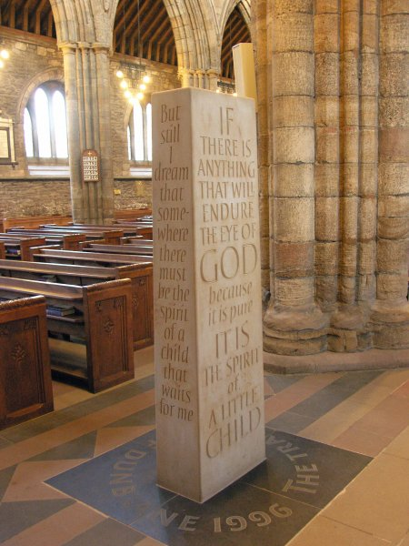 A standing stone in Dunblane Cathedral sculpted by Richard Kindersley commemorates the Dunblane, Scotland, school massacre, which killed 16 students and one teacher on March 13, 1996. File Photo by PaddyBriggs/Wikimedia