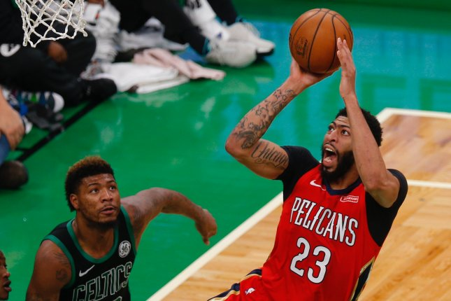 New Orleans Pelicans star Anthony Davisgoes up for a shot during a game against the Boston Celtics on December 10 at the TD Garden in Boston. Photo by C.J. Gunther/EPA-EFE