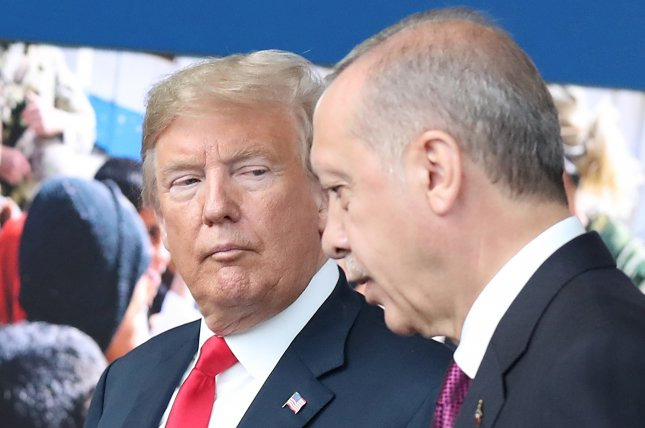 President Donald J. Trump (L) and Turkish President Recep Tayyip Erdogan met at NATO headquarters in Brussels on July 11, 2018. The United States has threatened economic sanctions if Turkey purchases the Russian AS-400 air defense system. File Photo by Tatyana Zenkovich/EPA-EFE