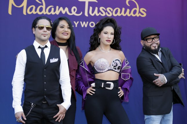 Selena Quintanilla's widower, Chris Perez (L), with her sister, Suzette Quintanilla (second from left), and brother, A.B. Quintanilla (R), at her Madame Tussauds unveiling ceremony on August 30, 2016. File Photo by Paul Buck/European Pressphoto Agency