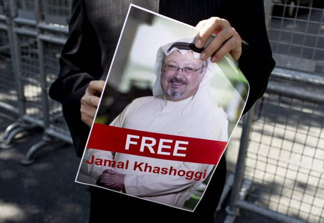 A protester holds a picture of Saudi Journalist Jamal Khashoggi during a demonstration organized by Turkish-Arabic Media Association in front of the Saudi Arabian consulate in Istanbul, Turkey, on Oct. 5. File Photo by Sedat Suna/EPA-EFE