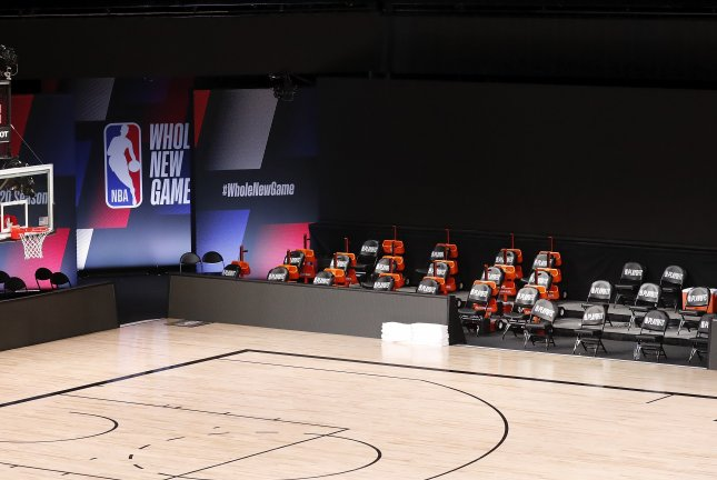The Milwaukee Bucks' bench area remains empty Wednesday inside AdventHealth Arena at the ESPN Wide World of Sports Complex near Orlando, Fla. The Bucks didn't take the court for Game 5 against the Orlando Magic in protest of the police shooting of 29-year-old Jacob Blake. Photo by John G. Mabanglo/EPA-EFE