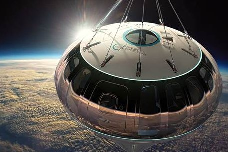A conceptual image shows the Spaceship Neptune, a project of aerospace firm Space Perspective, suspended from a hydrogen balloon in the stratosphere. Image courtesy of Space Perspective