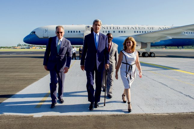 U.S. Secretary of State John Kerry (center) diplomat Jeffrey DeLaurentis (left), chargé d'affaires at the U.S. Embassy in Havana, and Cuban Ministry of Foreign Affairs Deputy Chief of Protocol Lidia Gonzales (right) are pictured at Jose Marti International Airport in Havana, Cuba, in August 2015. Tuesday, DeLaurentis was nominated by President Barack Obama to be the United States' first full ambassador to Cuba since 1961, but faces a battle with Republicans in the Senate, who must confirm him for the post. Photo courtesy U.S. Department of State