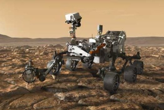 In this artist's conception, NASA's Perseverance Mars rover, which is scheduled to be launched Thursday, is shown using its instruments on the Red Planet. Image courtesy of NASA