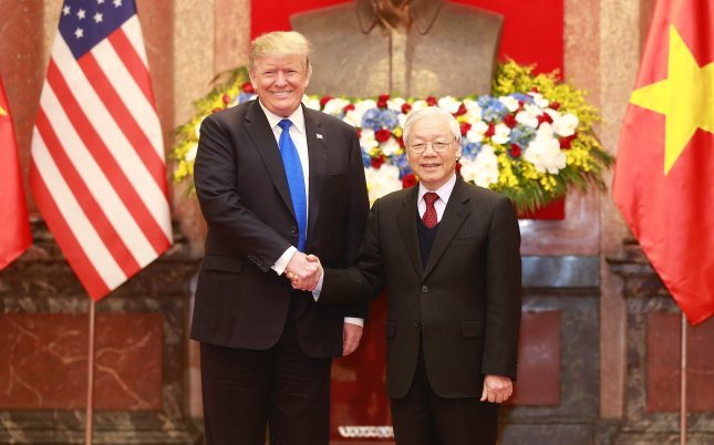 U.S. President Donald Trump (L) shakes hands with Vietnamese President Nguyen Phu Trong (R) during their meeting ahead of the US-North Korea summit in Hanoi, Vietnam. Photo by EPA-EFE/STR VIETNAM OUT