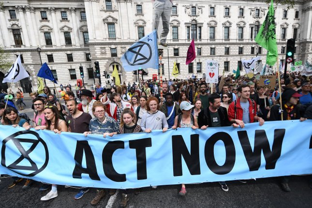 Extinction Rebellion protesters demonstrate Tuesday in Parliament Square in London, Britain. Photo by Andy Rain/EPA-EFE