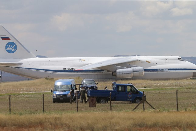 A Russian military cargo plane believed to be carrying parts of the S-400 anti-aircraft missile system purchased from Russia arrives at Murted Air Base in Ankara, Turkey, on Friday. Photo by EPA