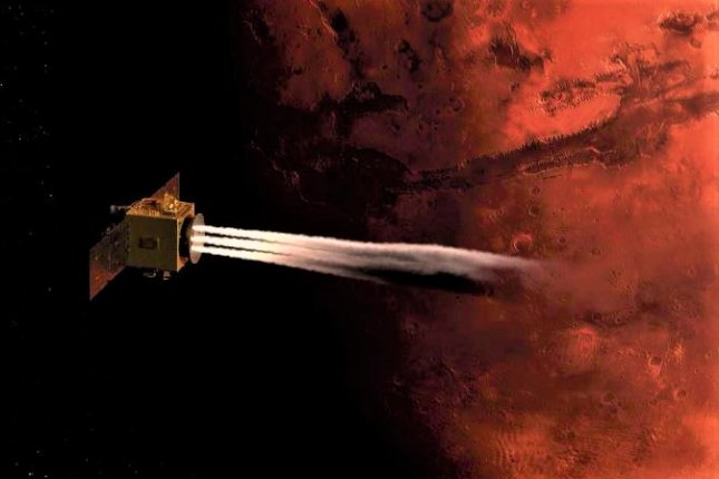 An illustration shows the United Arab Emirates' Mars Hope orbiter firing thrusters to slow itself down as it enters Mars orbit, which is scheduled to happen Tuesday. Image courtesy of Mohammed Bin Rashid Space Centre