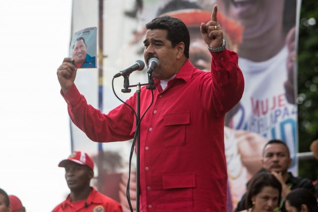 Venezuela's President Nicolas Maduro delivers a speech to supporters on Wednesday about the country's budget. The economic crisis there is bringing down the region's GDP. Photo by Cristian Hernández/EPA