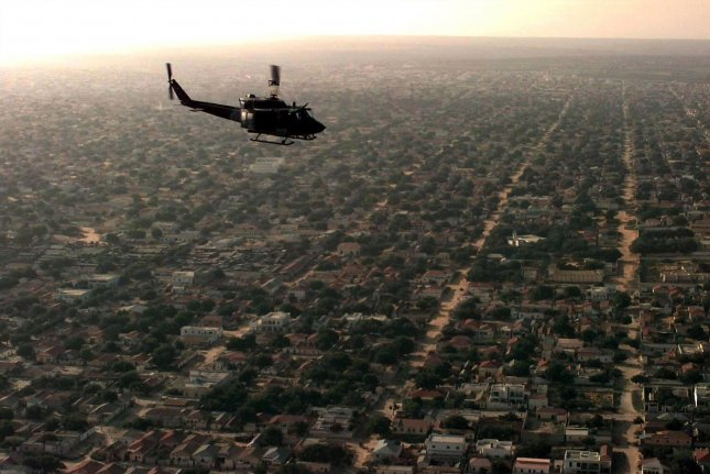 A U.S. Marine UH-1N Huey helicopter flies over Mogadishu, Somalia. A report by Amnesty International Wednesday said the U.S. military killed at least two civilians in airstrikes last month. File Photo by U.S. Air Force/UPI