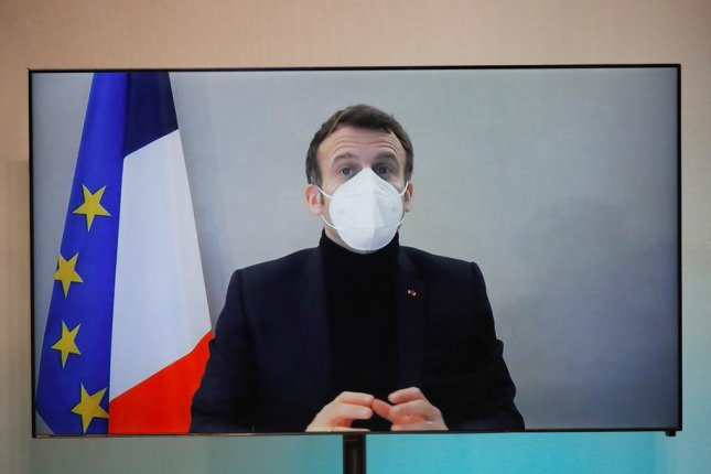 French President Emmanuel Macron remotely attends an event on Thursday for the National Humanitarian Conference, at the Foreign Ministry in Paris, France. Photo by Charles Platiau/EPA-EFE