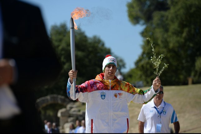 Greek Alpine skier Giannis Antoniou was the first to carry the Olympic torch at the beginning of its 123-day relay from Greece to Sochi for the 2014 Winter Olympics. (Flicker/International Olympic Committee)
