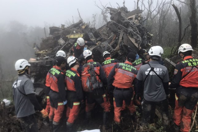 Yilan County Fire Bureau rescuers inspect the crash site of a UH-60M military helicopter near the mountains of Yilan county, Taiwan, on Thursday. Photo courtesy of Yilan County Fire Bureau/EPA-EFE