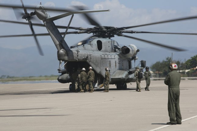 Marines with Special Purpose Marine Air-Ground Task Force Southern Command embark aboard CH-53E Super Stallion and depart to Grand Cayman Island at Soto Cano Air Base, Honduras, in October 2016. GE Aviation won a $9.6 million contract for work on the T-64, which powers the Super Stallion. Photo by Ian Ferro/United States Marine Corps