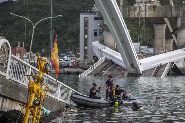Rescuers search for survivors Tuesday after the Nanfangao Bridge in Nanfangao, Taiwan, collapsed and killed at least 2 people. Photo by Ritchie B Tongo/EPA-EFE