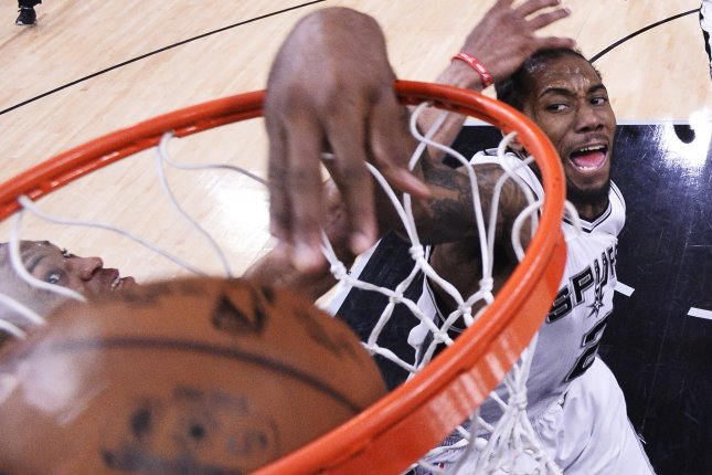 San Antonio Spurs forward Kawhi Leonard (R) dunks the ball against the Oklahoma City Thunder during the second half of the NBA Western Conference semifinal basketball game five between the Oklahoma City Thunder and the San Antonio Spurs at the AT&T Center in San Antonio, Texas, USA, 10 May 2016. File photo by LARRY W. SMITH/EPA