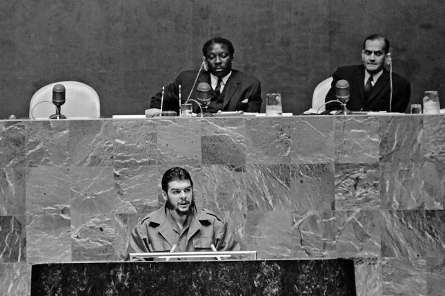 Mr. Ernesto Che Guevara (at speakers rostrum), Minister of Industries of Cuba, is seen addressing the United Nations General Assembly on December 11, 1964. At the presidential rostrum are Mr. Alex Quaison-Sackey (left) of Ghana, Asssembly President, and Mr. G.V. Narasimhan, Under-Secretary for General Assembly Affairs and Chef de Cabinet. UN Photo