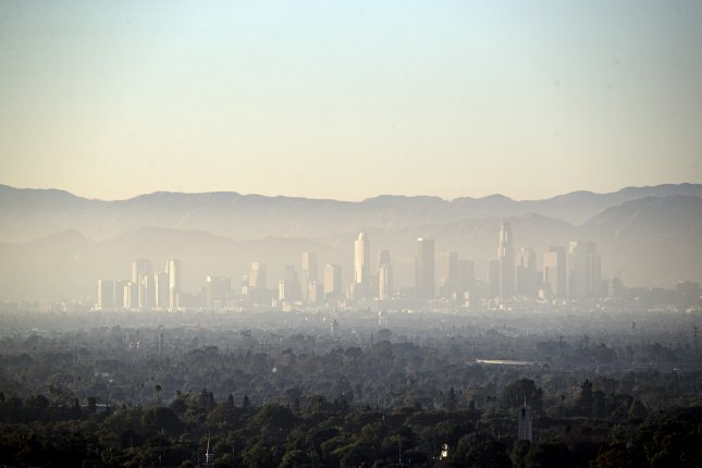 A layer of smog covers downtown and the nearby areas of Los Angeles on August 14, 2019. Photo by Etienne Laurent/EPA-EFE