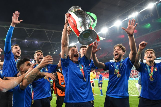 Matteo Pessina (C) of Italy lifts the trophy alongside his teammates after winning the UEFA Euro 2020 final against England on Sunday at Wembley Stadium in London. Photo by Andy Rain/EPA-EFE