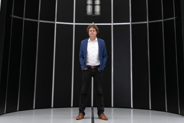 Peter Beck, founder and CEO of Long Beach, Calif.-based Rocket Lab, stands in front of a model of a fairing, or nose cone, for the company's planned Neutron rocket. Photo courtesy of Rocket Lab