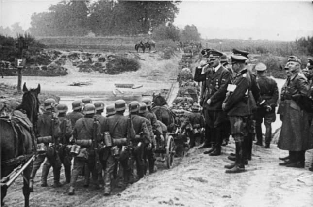 German leader Adolf Hitler presides over infantry soldiers during Germany's invasion of Poland in September 1939. File Photo courtesy Das Bundesarchiv