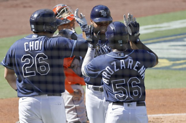Tampa Bay Rays outfielder Manuel Margot (C) is greeted by teammates Ji-Man Choi (L) and Randy Arozarena (R) after hitting a three-run home run during the first inning in Game 2 of the American League Championship Series on Monday at Petco Park in San Diego, Calif. Photo by John G. Mabanglo/EPA-EFE