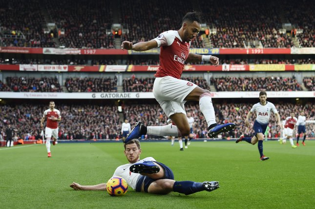 Arsenal's Pierre-Emerick Aubameyang (R) vies for the ball against Tottenham's Jan Vertonghen (L) during their English Premier League soccer match on Sunday at the Emirates Stadium in London. Photo by Will Oliver/EPA-EFE