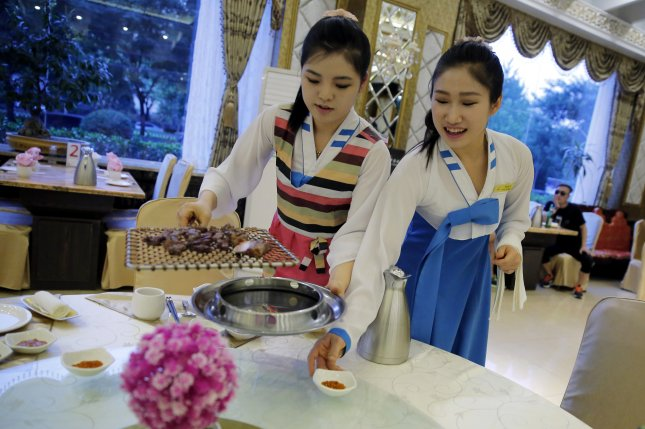 A file picture dated 02 June 2016 shows North Korean waitresses serving guests at a North Korean-run restaurant in Beijing, China.12 North Korean women who worked in a North Korean restaurant in China defected to the South two monts earlier. File Photo by EPA/Wu Hong.