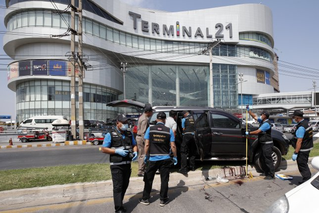 Thai forensic police officers inspect car of a shooting victim at the scene of a mass shooting outside the Terminal 21 shopping mall in Nakhon Ratchasima, Thailand, on Sunday. Photo by Rungroj Yongrit/EPA-EFE