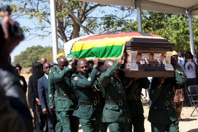 Pall-bearers carry the coffin of the late former Zimbabwean president Robert Mugabe in the Zvimba district of Zimbabwe on Saturday. Photo by Aaron Ufumeli/EPA-EFE