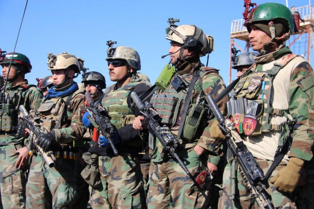 Afghan Army soldiers man a checkpoint in Helmand, Afghanistan, on February 22. File Photo by Watan Yar/EPA-EFE