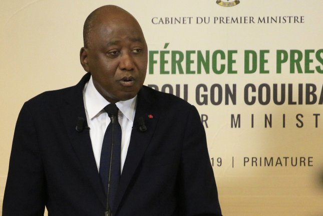 Ivory Coast Prime Minister Amadou Gon Coulibaly died at the age of 61 following a Cabinet meeting after he returned from France for a heart procedure. Photo by Legnan Koula/EPA-EFE