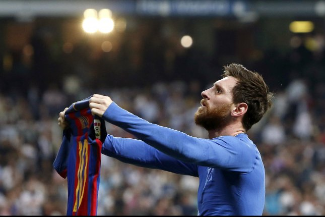 FC Barcelona's Argentinian striker Lionel Messi celebrates the 3-2-victory against Real Madrid during the Liga Primera Division 33rd round match between Real Madrid and FC Barcelona Sunday at the Santiago Bernabeu stadium in Madrid. Photo by Juan Carlos Hidalgo/EPA