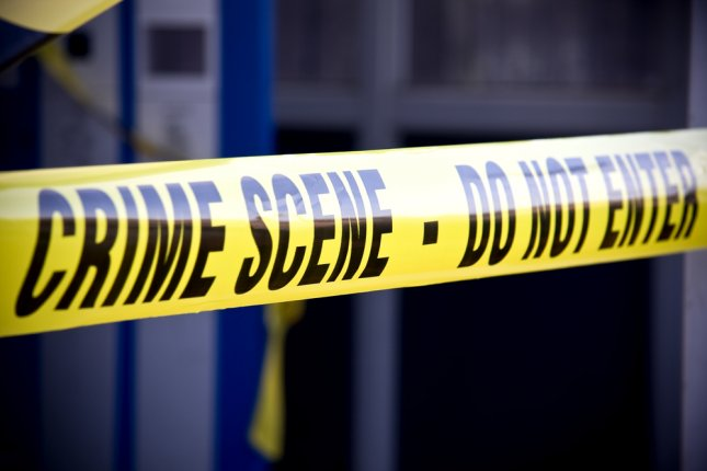 Close up of crime scene investigation police boundary tape. Brian A Jackson/Shutterstock