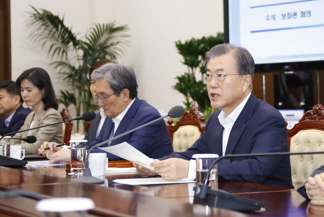 South Korean President Moon Jae-in called for stronger regulations to combat phone scams and online fraud on Monday. File Photo by Yonhap