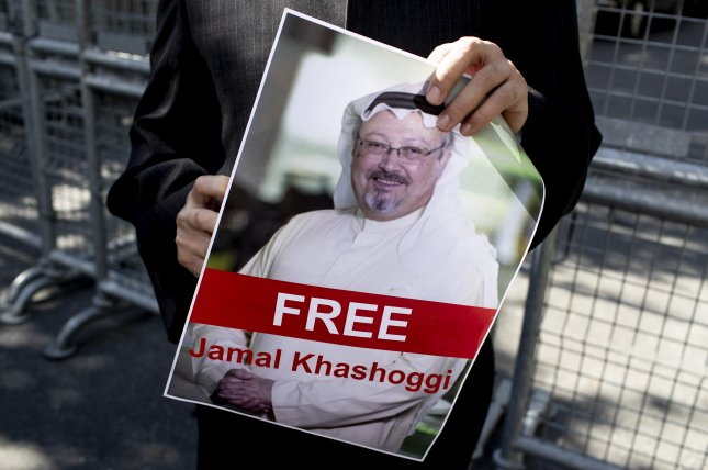 A protester holds a picture of Saudi columnist Jamal Khashoggi during a demonstration in front of the Saudi Arabian consulate in Istanbul, Turkey, on October 5. Khashoggi went missing after visiting the consulate. Photo by Sedat Suna/EPA-EFE