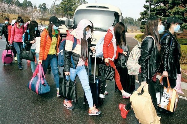 Twelve female workers of the Ryukyung Restaurant, a North Korean establishment in Ningbo, China, arrived in South Korea in April 2016, along with their male manager. File Photo courtesy of Republic of Korea Ministry of Unification