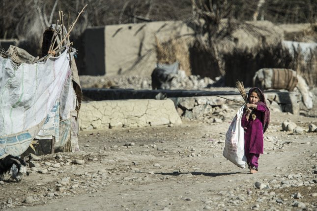 A young refugee is seen at a place known as Tent City outside of Camp Fenty in Afghanistan. File Photo by Staff Sgt. Corey Hook/U.S. Air Force/UPI