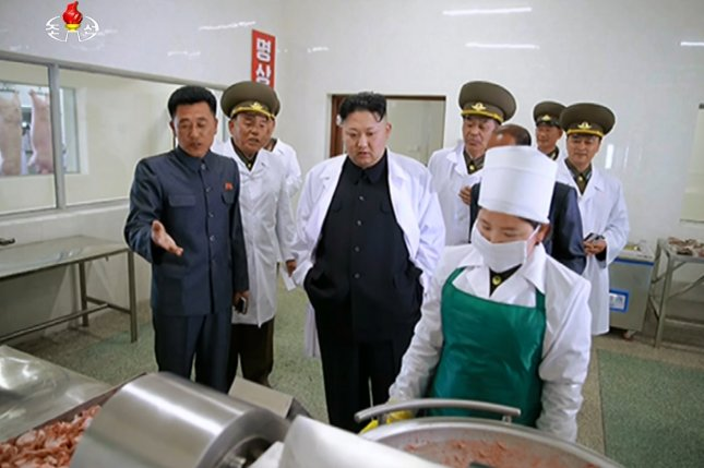 North Korean leader Kim Jong Un (C) tours a pig farm run by a North Korean Air Force unit. Some other farmers are being asked to grow marijuana. Photo by Yonhap News Agency/UPI