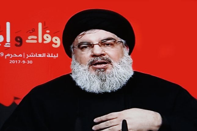 Hezbollah leader Sayed Hassan Nasrallah gives a televised address Saturday from his bunker in Lebanon. Screen grab from Al-Manar TV/EPA