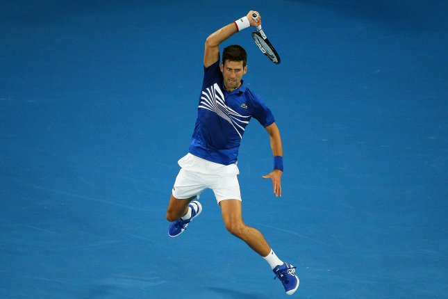 Novak Djokovic of Serbia in action against Lucas Pouille of France during their men's singles semifinal match at the Australian Open Grand Slam tennis tournament on Friday in Melbourne. Photo by Hamish Blair/EPA-EFE