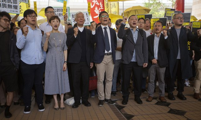 Pro-democracy activists (L-R) Eason Chung Yiu-wah, Tommy Cheung Sau-yin, Tanya Chan, Chu Yiu-ming, Dr. Chan Kin-man, Benny Tai, Lee Wing-tat and Shiu Ka-chun were convicted of public nuisance charges for their roles behind the 2014 Umbrella Movement protests. Photo by Alex Hofford/EPA-EFE
