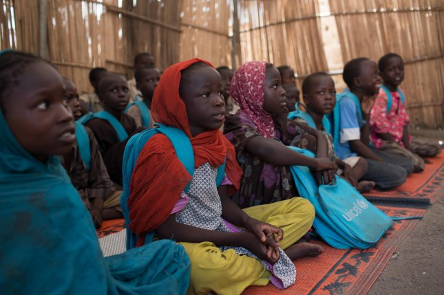 Children attend school in the town of Banki, Nigeria, in 2017 after the military recaptured it from Boko Haram. Photo courtesy UNICEF