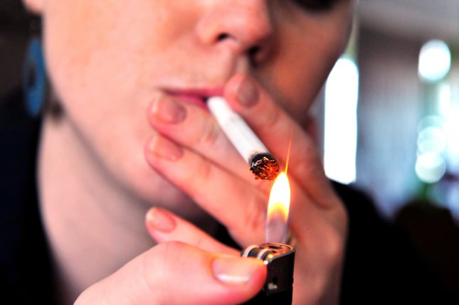 Most Americans favor raising the minimum age to buy tobacco to 21, Gallup said Thursday. File Photo by ChameleonsEye/Shutterstock