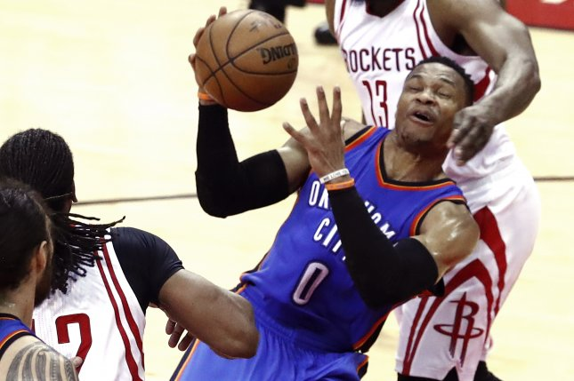 b40ef51a6c4 Oklahoma City Thunder guard Russell Westbrook (C) is fouled by Houston  Rockets guard James Harden (R) while going to the basket in the first half  of Game 2 ...